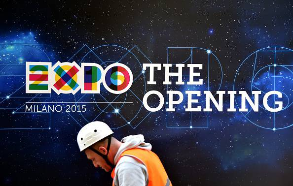A worker works to finish preparations for the Universal Exposition Milano 2015, EXPO2015, on April 29, 2015 in Milan. The exposition will run from May 1st, 2015 to October 31, 2015 on the theme of Feeding the Planet, Energy for Life. The fair focuses on food security, sustainable agricultural practices, nutrition and battling hunger - as well as dishing out the best fare of the world's culinary cultures. Cooking shows, restaurants, and food stalls will be designed to attract and hold visitors in Italy's financial capital. AFP PHOTO / OLIVIER MORIN        (Photo credit should read OLIVIER MORIN/AFP/Getty Images)