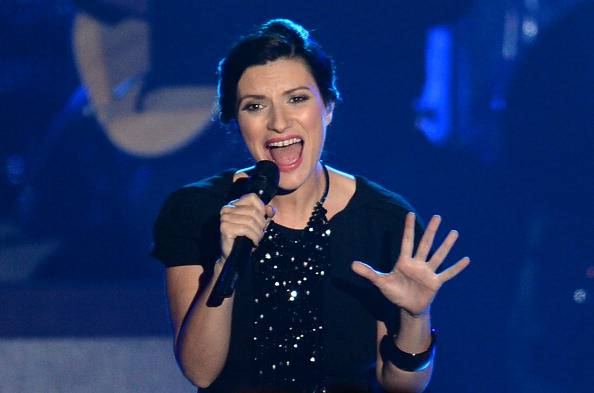 Laura Pausini performs on stage at the 2013 Latin Recording Academy Person of the Year Tribute Gala, November 20, 2013 at the Mandalay Bay Resort and Casino in Las Vegas, Nevada.  The 2013 Latin Recording Academy Person of the Year honoree is Spanish/Italian musician and actor Miguel Bose.  AFP PHOTO / Robyn Beck        (Photo credit should read ROBYN BECK/AFP/Getty Images)