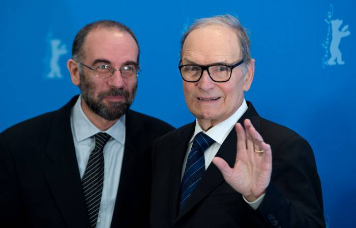 "Italian composer Ennio Morricone (R) and Italian diector Giuseppe Tornatore pose for photographers during a photocall for the film 'The Best Offer' shown in the ""Berlinale Special"" section of the 63rd Berlinale Film Festival in Berlin February 12, 2013.   AFP PHOTO / JOHANNES EISELE        (Photo credit should read JOHANNES EISELE/AFP/Getty Images)"
