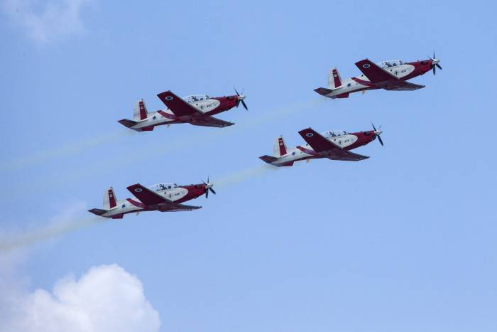 Israeli Efroni T-6 Texan II planes perform during an air show over the beach in the coastal city of Tel Aviv on April 23, 2015 as Israel marks Independence Day, 67 years since the establishment of the Jewish state. Israel's first prime minister David Ben-Gurion declared the existence of the State of Israel in Tel Aviv in 1948, ending the British mandate. AFP PHOTO / JACK GUEZ        (Photo credit should read JACK GUEZ/AFP/Getty Images)
