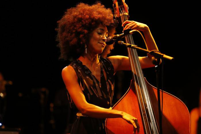 US jazz bassist and singer Esperanza Spalding performs on stage at the Nice Jazz Festival on July 12, 2013 in Nice, southeastern France. AFP PHOTO / VALERY HACHE        (Photo credit should read VALERY HACHE/AFP/Getty Images)