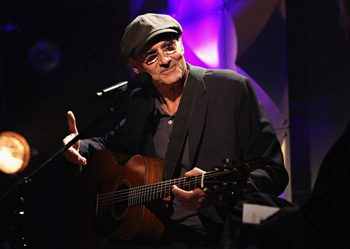NEW YORK, NY - JUNE 22:  Singer-songwriter James Taylor performs during iHeartRadio ICONS with James Taylor presented by P.C. Richard & Son at iHeartRadio Theater on June 22, 2015 in New York City.  (Photo by Cindy Ord/Getty Images for iHeartRadio)
