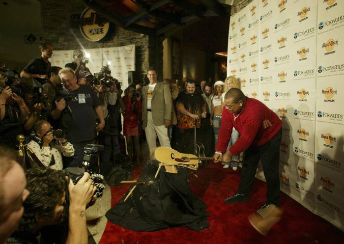 MASHANTUCKET, CT - AUGUST 19:  Mashantucket Pequot Tribal Nation chairman Michael Thomas breaks a guitar at the grand opening of the Hard Rock Cafe at the Foxwoods Resort Casino August 19, 2004 in Mashantucket, Connecticut.  (Photo by Bob Falcetti/Getty Images)