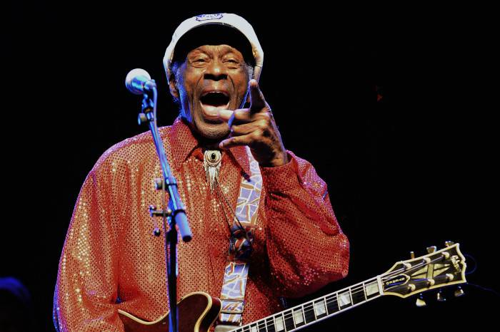 Legendary US singer and composer Chuck Berry, one of the pioneers of rock-and-roll, performs at a concert in Montevideo on April 15, 2013.  AFP PHOTO/Pablo PORCIUNCULA        (Photo credit should read PABLO PORCIUNCULA/AFP/Getty Images)