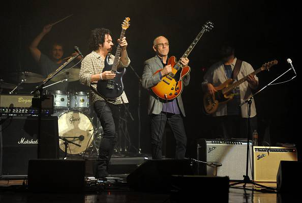 US guitarists Steve Lukather (centre L) and Larry Carlton (centre R) perform at the last show of their 2015 Asian tour, at the AC Hall in Hong Kong on February 5, 2015. Lukather, known for his work with the US rock group Toto in the 1980s, and multi-Grammy Award winning Carlton, appeared together as part of the Jazz World Live Series.    AFP PHOTO / RICHARD A. BROOKS        (Photo credit should read RICHARD A. BROOKS/AFP/Getty Images)