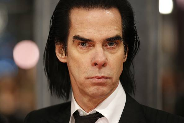 British musician Nick Cave poses on the red carpet for the BAFTA British Academy Film Awards at the Royal Opera House in London on February 8, 2015. AFP PHOTO / JUSTIN TALLIS        (Photo credit should read JUSTIN TALLIS/AFP/Getty Images)