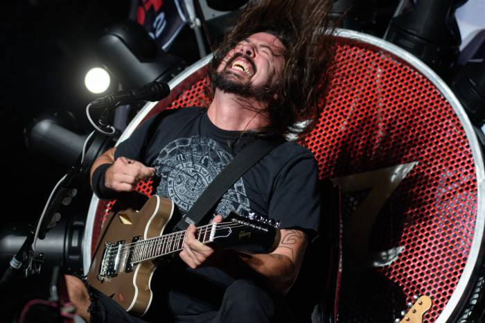 Dave Grohl of the band Foo Fighters performs at the Ansan Valley Rock Festival in Ansan, south of Seoul on July 26, 2015. The Ansan Valley Rock Festival is an annual music festival featuring a mix of regional and international acts. RESTRICTED TO EDITORIAL USE AFP PHOTO / Ed Jones        (Photo credit should read ED JONES/AFP/Getty Images)