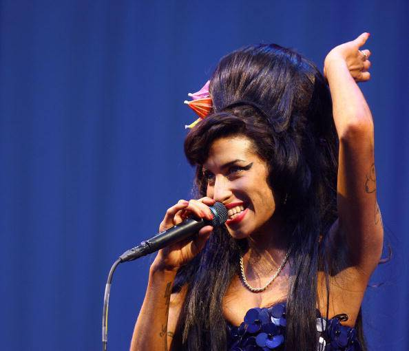 British singer Amy Winehouse performs at the Glastonbury Festival at Worthy Farm, in Glastonbury on June 28, 2008. AFP PHOTO/BEN STANSALL (Photo credit should read BEN STANSALL/AFP/Getty Images)