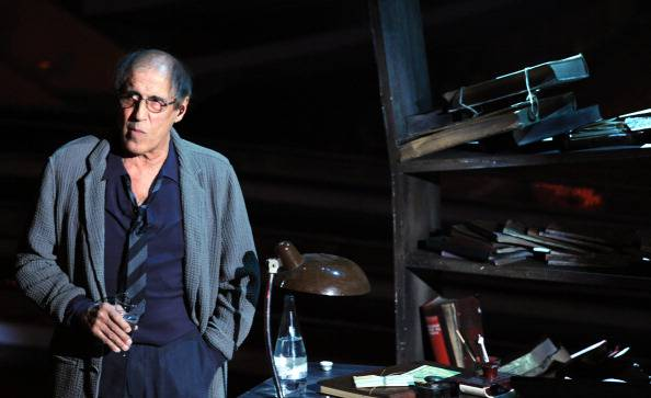 Italian actor-singer Adriano Celentano performs on the stage of Ariston Theatre in Sanremo, during the 62th Italian Music Festival on February 18, 2012. AFP PHOTO/ Tiziana Fabi (Photo credit should read TIZIANA FABI/AFP/Getty Images)