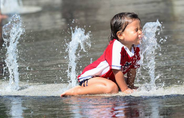 A child cools off in a water fountain plaza at Grand Park in downtown Los Angeles, California, on June 2, 2013, where summer afternoon temperatures reached 75 degrees. AFP PHOTO/Federic J. BROWN        (Photo credit should read FREDERIC J. BROWN/AFP/Getty Images)