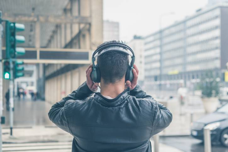 Back view of a young man with headphones