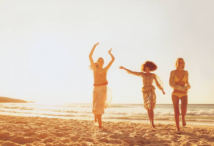 Three Women Running on the Beach