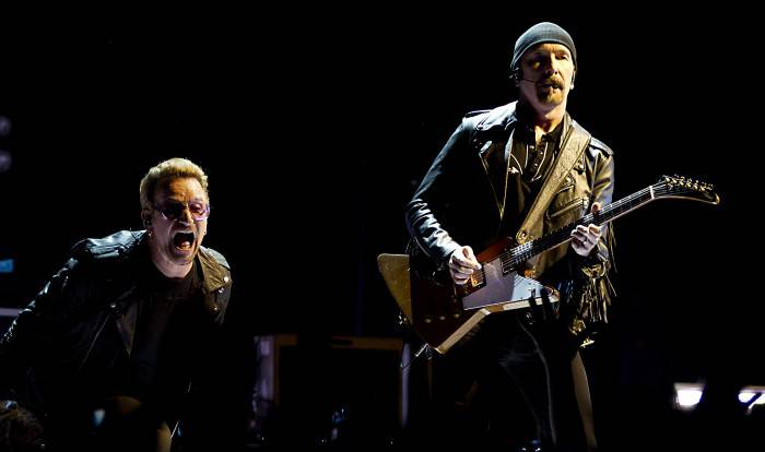 "Irish band U2 perform at the Ziggo Dome in Amsterdam on September 8, 2015, part of their ""iNNOCENCE + eXPERIENCE"" Tour 2015.  AFP PHOTO / ANP / PAUL BERGEN ***NETHERLANDS OUT***        (Photo credit should read PAUL BERGEN/AFP/Getty Images)"