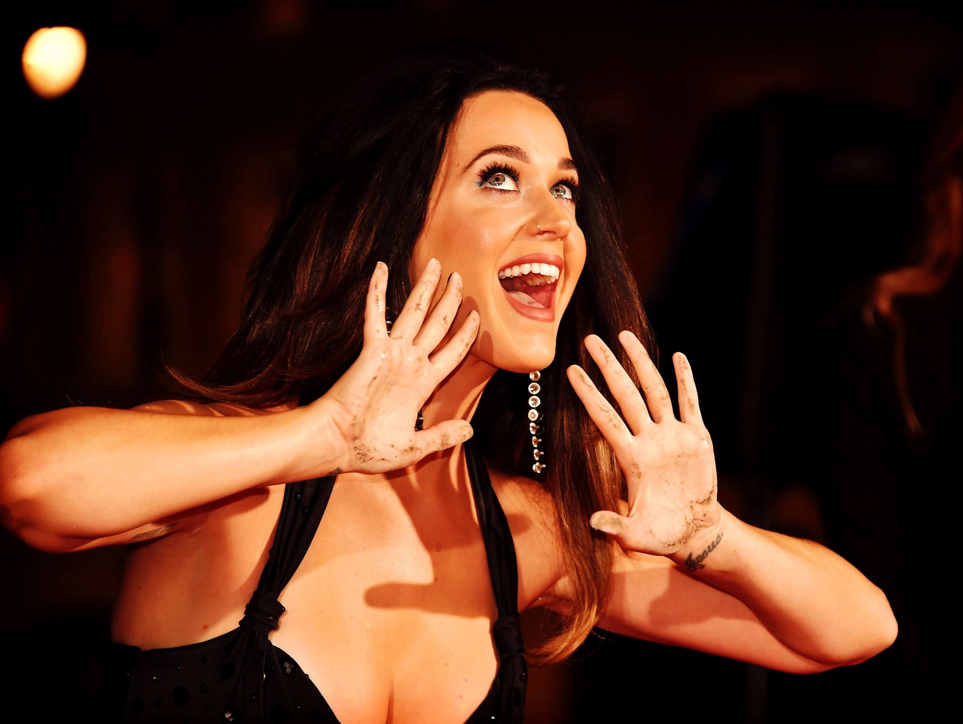 HOLLYWOOD, CA - SEPTEMBER 08: (Editors Note: Image has been processed using digital filters) Singer Katy Perry is honored during her hand print ceremony at TCL Chinese Theatre IMAX Forecourt on September 8, 2015 in Hollywood, California. (Photo by Alberto E. Rodriguez/Getty Images)