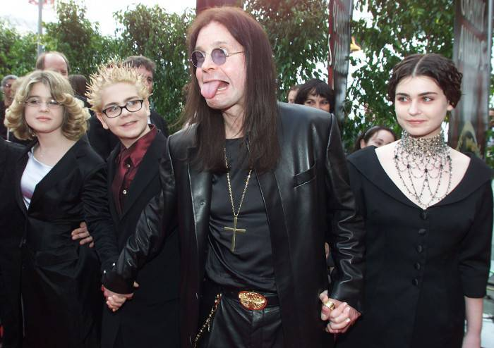 "LOS ANGELES, UNITED STATES:  British Metal Artist Ozzy Osbourne (C) arrives at the 42nd Grammy Awards Ceremony with his family in Los Angeles, CA, 23 February, 2000.          Osbourne's group ""Black Sabbath"" won a Grammy for Best Metal Performance for the song ""Iron Man"" on the album ""Reunion"". (ELECTRONIC IMAGE) AFP PHOTO/Lucy NICHOLSON/ln (Photo credit should read LUCY NICHOLSON/AFP/Getty Images)"