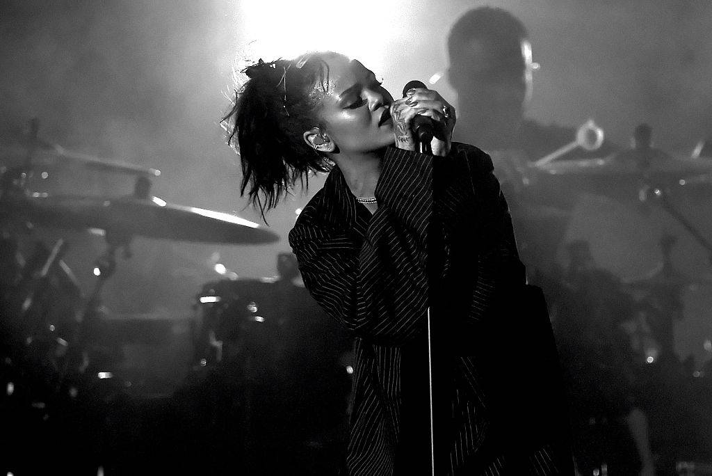 HOLLYWOOD, CA - OCTOBER 24:  (EDITOR'S NOTE:  Image has been shot in black and white.)  Recording artist Rihanna performs onstage during CBS RADIOs third annual We Can Survive, presented by Chrysler, at the Hollywood Bowl on October 24, 2015 in Hollywood, California.  (Photo by Kevin Winter/Getty Images for CBS Radio Inc.)