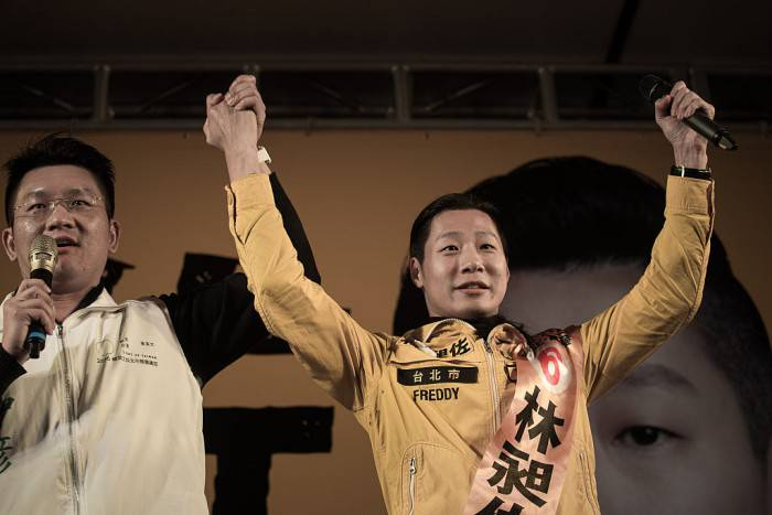 Freddy Lim (R), a candidate from the New Power Party and singer of Chthonic - one of Asia's biggest death metal bands - attends an election rally in Taipei on January 14, 2016.  Voters in Taiwan are set to elect a Beijing-sceptic president as they take the latest step in a dramatic democratic journey, carving their own political path against China's wishes. AFP PHOTO / Philippe Lopez / AFP / PHILIPPE LOPEZ        (Photo credit should read PHILIPPE LOPEZ/AFP/Getty Images)