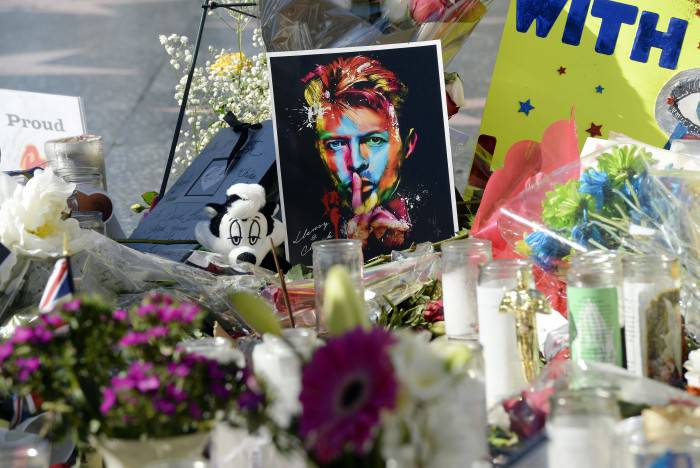 HOLLYWOOD, CA - JANUARY 12:  Candles, flowers and personal notes are placed as a memorial to musician David Bowie on his Hollywood Walk of Fame star on January 12, 2016, in Hollywood, California. (Photo by Kevork Djansezian/Getty Images)