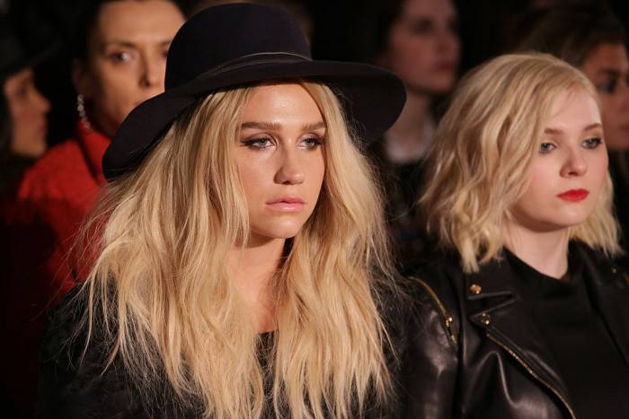 NEW YORK, NY - FEBRUARY 16:  Singer Kesha (L) and actress Abigail Breslin attend the Zac Posen fashion show at Vanderbilt Hall at Grand Central Terminal on February 16, 2015 in New York City.  (Photo by Chelsea Lauren/Getty Images)