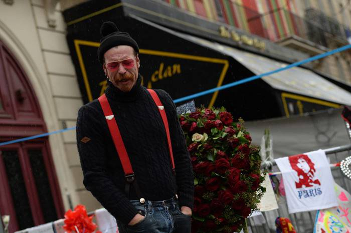 Singer of the US rock group Eagles of Death metal Jesse Hughes pays tribute to the victims of the November 13 Paris terrorist attacks at a makeshift memorial in front of the Bataclan concert hall on December 8, 2015 in Paris.  The Eagles of Death Metal band returned to the Bataclan concert hall in Paris, nearly a month after they survived a jihadist attack there in which 90 people died. / AFP / MIGUEL MEDINA        (Photo credit should read MIGUEL MEDINA/AFP/Getty Images)