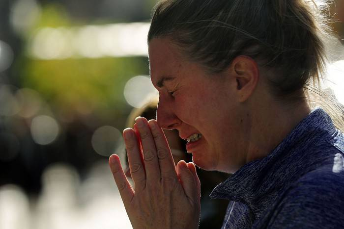 NEW YORK, NY - NOVEMBER 14:  A woman cries outside of the Consulate General of France in New York the day after an attack on civilians in Paris on November 14, 2015 in New York City. At least 100 people were killed in a popular Paris concert hall, one of at least 6 terror attacks in the French capital. The French president Francois Hollande closed French borders following the attacks.  (Photo by Spencer Platt/Getty Images)