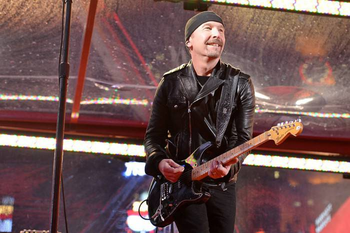 NEW YORK, NY - DECEMBER 01:  Guitarist The Edge of U2 performs on World AIDS Day at 'A (RED) Thank You,' presented by (Bank of America)RED on December 1, 2014 in New York City.  (Photo by Slaven Vlasic/Getty Images for (RED))