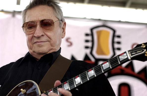 MEMPHIS - JULY 5:  Musician Scotty Moore performs for the crowd at the 50th Anniversary of Rock 'N Roll Reunion celebration on July 5, 2004 at Sun Studio in Memphis, Tennessee. Moore, recently names one of the 50 greatest guitarist of all time by Rolling Stone magazine, played lead guitar on all of Elvis Presley Sun Records recordings.  (Photo by Mike Brown/Getty Images)