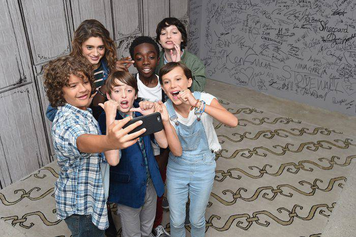 "NEW YORK, NY - AUGUST 31:  (L-R) Actors Gaten Matarazzo, Natalia Dyer, Noah Schnapp, Caleb McLaughlin, Finn Wolfhard and Millie Bobby Brown (front right) of ""Stranger Things"" attend the BUILD Series at AOL HQ on August 31, 2016 in New York City.  (Photo by Michael Loccisano/Getty Images)"