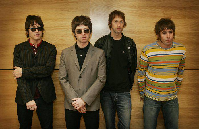 "(FILES) (From L) Members of the British rock band ""Oasis"" Gem, Noel Gallagher, Andy Bell and Liam Gallagher hold a photocall in Hong Kong on February 25, 2006. The future of British rock group Oasis was plunged into doubt on August 28, 2009 after lead guitarist Noel Gallagher dramatically announced he was quitting because he can no longer work with his brother Liam.   AFP PHOTO/MIKE CLARKE (Photo credit should read MIKE CLARKE/AFP/Getty Images)"