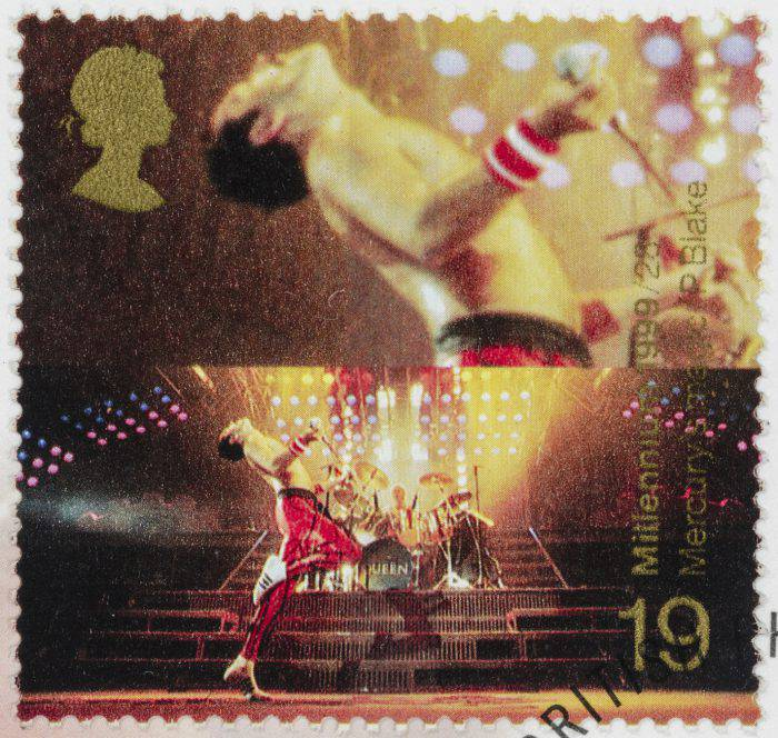 """""""Sacramento, California, USA - October 4, 2012: A 1999 UK postage stamp with a photo of Freddie Mercury (1946 - 1991) from the rock band Queen. Issued as part of the Millennium stamp series celebrating the 20th century."""""""